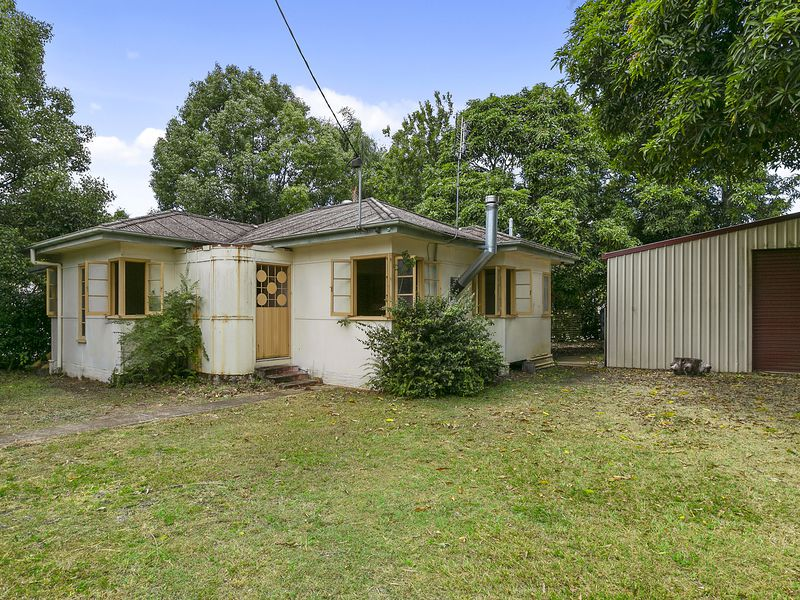 Well located Renovator with huge shed.